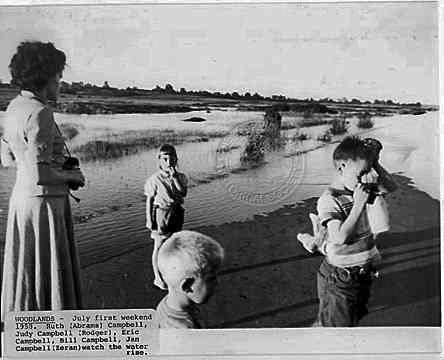 July first weekend 1958. Ruth (Abrams) Campbell, Judy Campbell, (Rodger), Eric Campbell, Bill Campbell, Jan Campbell (Zeran) watch the water rise.